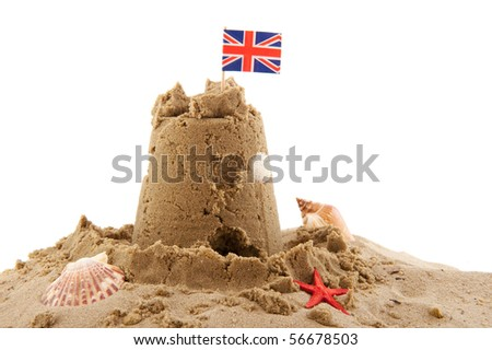 Beach with sand castle in England isolated over white - stock photo