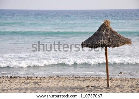 Beach with umbrellas on the Tenerife, Canary islands, Spain - stock photo