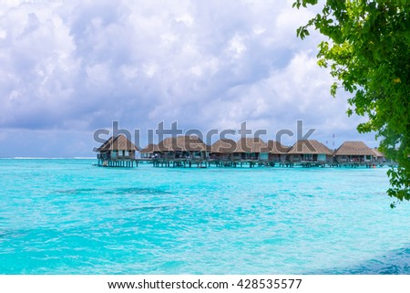 Beach with water bungalows at Maldives. - stock photo