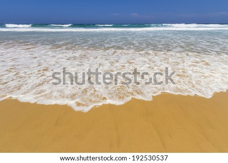 Beach with wave - stock photo