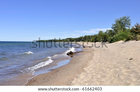 beach with waves and summer sky - stock photo