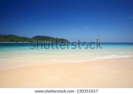 Beach with yacht in andaman sea, Koh Rok or Rok Island ,Thailand - stock photo
