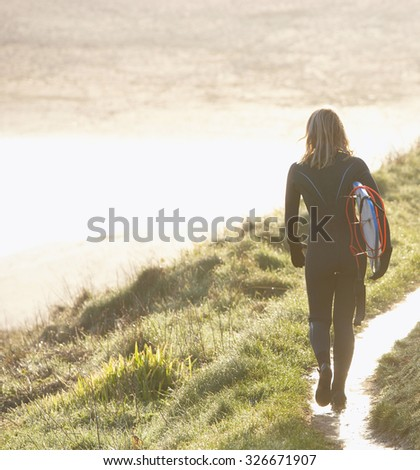 Beach woman  with body surfboard - stock photo