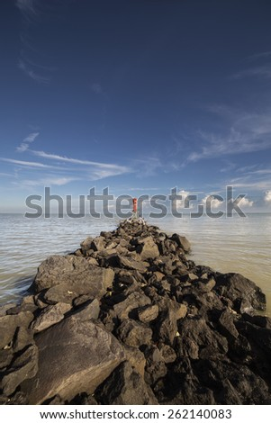 Beacon at the Tip of the Rocky Path - stock photo