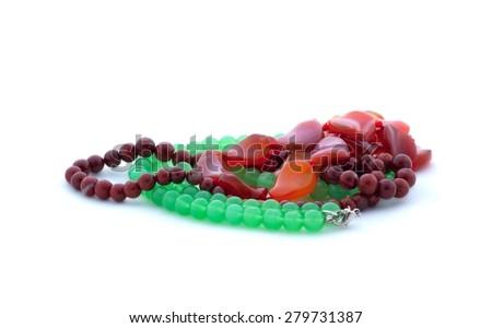 Bead-necklaces on white - stock photo