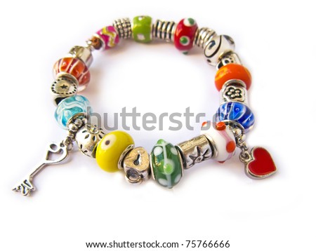 Beads and gems bracelet isolated in white - stock photo