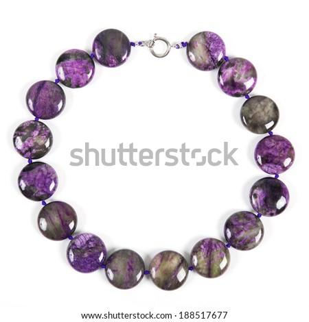Beads from charoite - stock photo