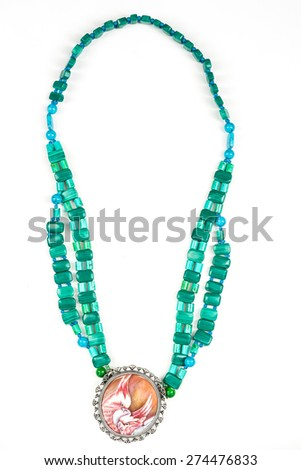 Beads from natural stones on white background. Top view - stock photo