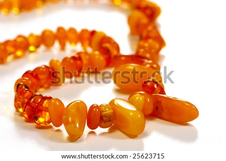 beads, necklace made of amber on white - stock photo