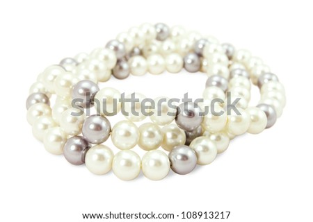 beads of white and black pearls on a white background - stock photo