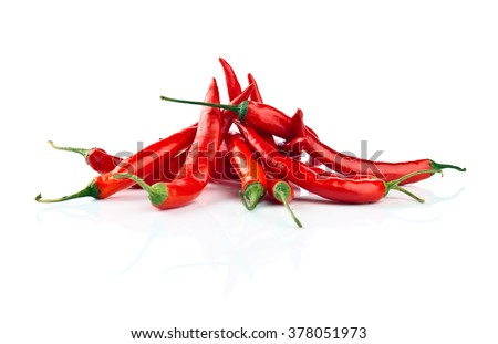 beam of red Chile pepper on white reflexive background - stock photo