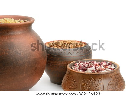 Beans, rice and lentils in pots isolated on white - stock photo