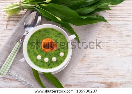 Bear allium soup with smoking salmon - stock photo