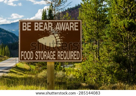 Bear Aware sign in remote area warning sign - stock photo