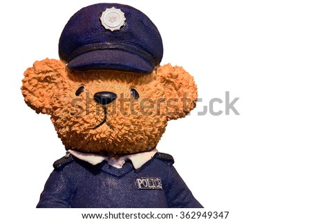 Bear figure doll wears police officer uniform and put a hat has police sign at sunshine light and shadow on midday, Isolated on white background. - stock photo