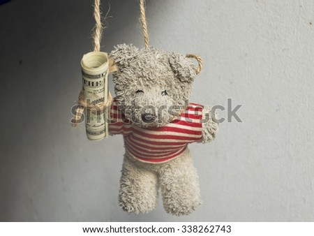 bear Strangled to death with money - stock photo