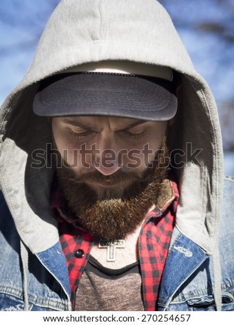 beard face looking down with hat and hood - stock photo