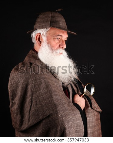 Bearded detective with magnifying glass - stock photo