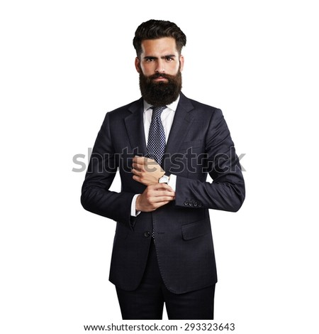 Bearded handsome man wearing smart suit - stock photo