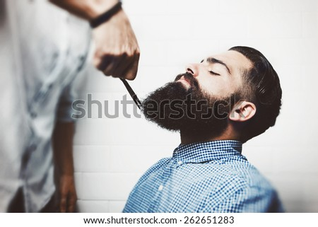 Bearded hipster in a barber shop - stock photo