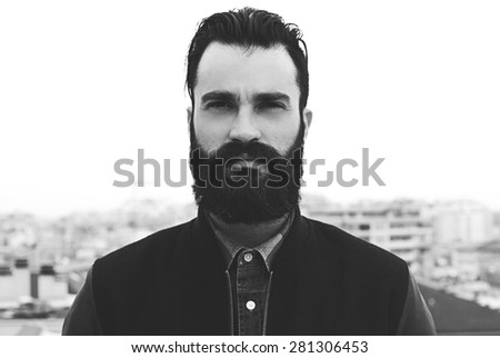 Bearded man black and white portrait - stock photo