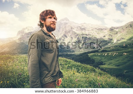 Bearded Man hiking Travel Lifestyle concept mountains on background Summer journey adventure vacations outdoor - stock photo
