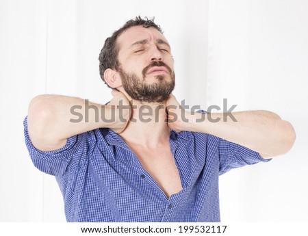 bearded man in blue shirt having a headache - stock photo