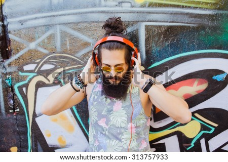 Bearded man,lifestyle portrait of hipster man,cool beard.Mans hairstyle.haircut,hairdresser.Stylish man posing with cool hairstyle,wall,ready to car trip.Happy  active,NYC,California,east coast.Hiker  - stock photo