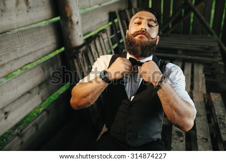 bearded man with a very interesting look - stock photo