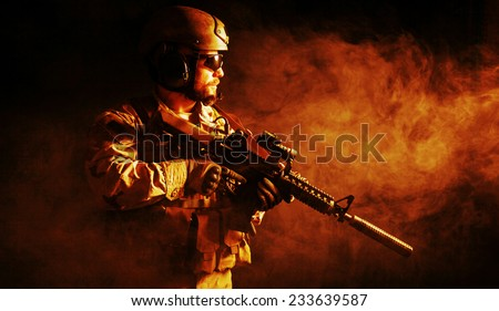 Bearded special forces soldier  in the fire - stock photo