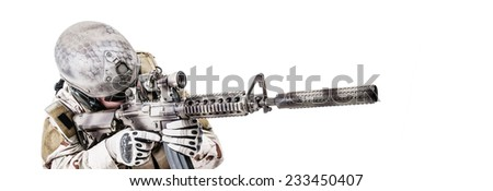 Bearded special warfare operator with assault rifle - stock photo