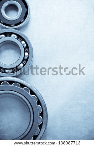 bearings at metal  background texture - stock photo