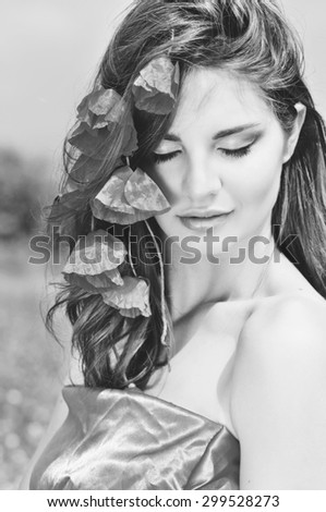 beatiful girl with poppies in red hair - stock photo
