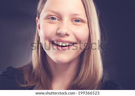 Beatiful, happy teen girl laughing - stock photo
