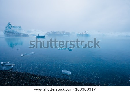 Beatufil vibrant picture of icelandic glacier and glacier lagoon with water and ice in cold blue tones  - stock photo