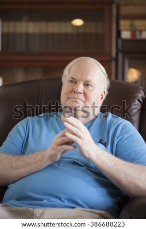 BEAUFORT, SOUTH CAROLINA, USA- SEPTEMBER 17, 2015: Candid portrait of famous writer Pat Conroy during an interview in September 2015. Conroy died March 4, 2016. - stock photo