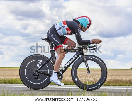BEAUROUVRE,FRANCE,JUL 21:The American cyclist Christopher Horner from Team RadioShack-Nissan pedaling during the 19 stage- a time trial between Bonneval and Chartres on July 21 2012 - stock photo