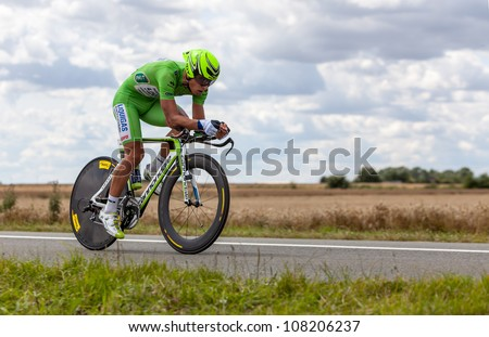 BEAUROUVRE,FRANCE,JUL 21:The cyclist Sagan Peter (Liquigas-Cannondale) wearing The Green Jersey during the 19 stage- a time trial  between Bonneval and Chartres- of Le Tour de France on July 21 2012. - stock photo