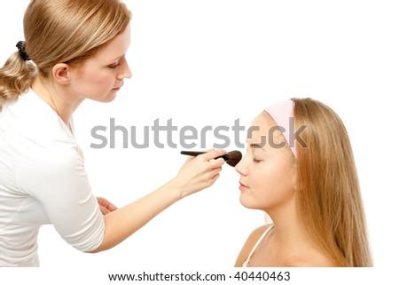 Beautician Applying Woman's Make Up - stock photo