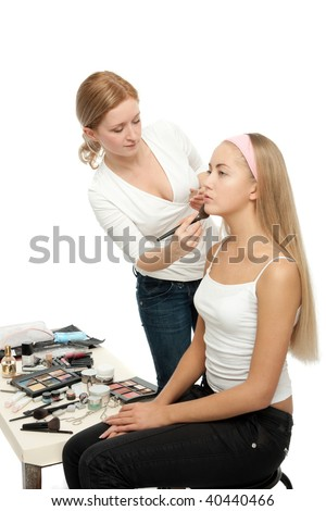 Beautician Applying Woman's Make Up - stock photo