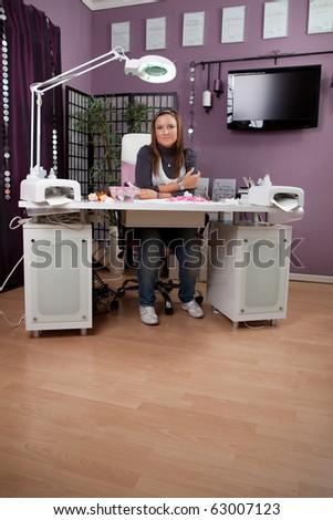 Beautician in her nail studio - stock photo
