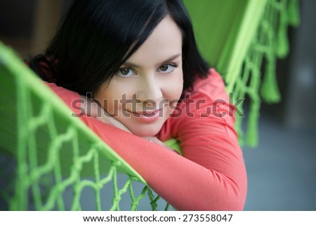 Beautifil woman rest in green hammock indoor - stock photo