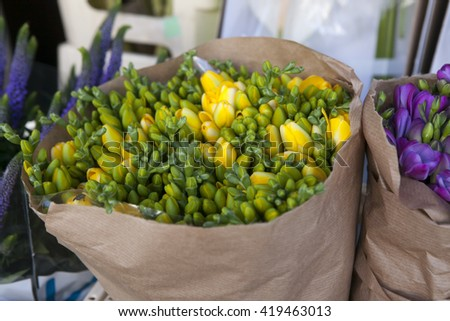 Beautifu yellowl freesia flowers bouquet  in craft paper - stock photo