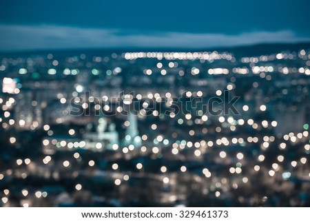 beautiful abstract blue circular bokeh background, city lights with horizon and instagram style - stock photo