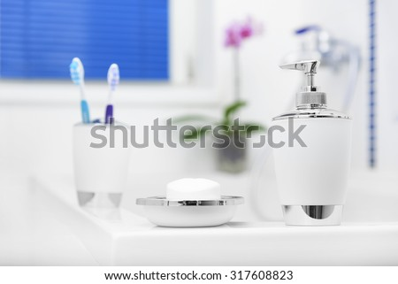 Beautiful accessories in white bathroom. Personal hygiene items. - stock photo