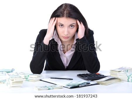 Beautiful accountant using calculator to count cash on a white background - stock photo