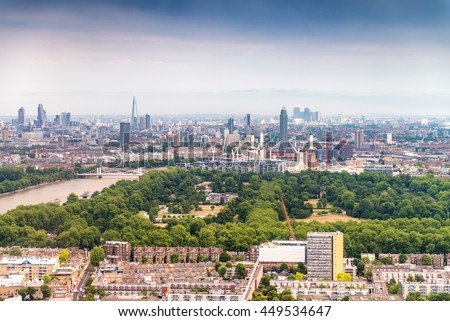 Beautiful aerial view of London with buildings and trees. - stock photo