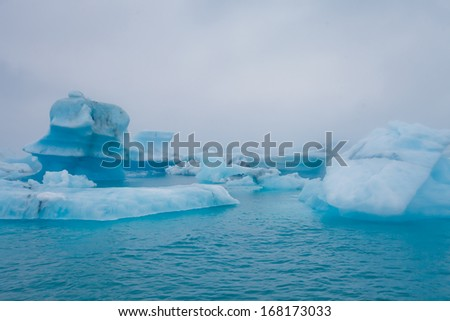 Beautiful aerial view on icelandic glacier and glacier lagoon - stock photo