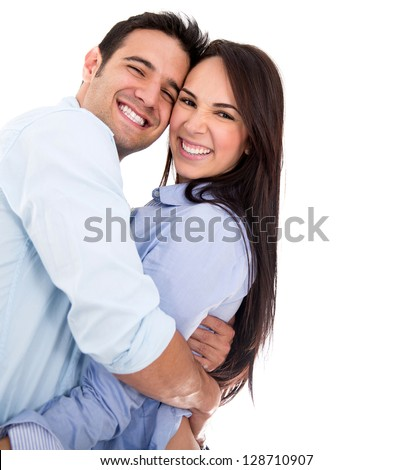 Beautiful affectionate couple smiling - isolated over a white background - stock photo
