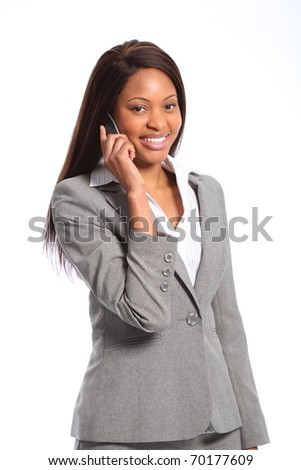 Beautiful african american business woman on telephone - stock photo